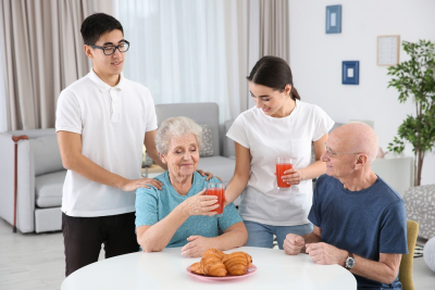 Senior people with young caregivers at home
