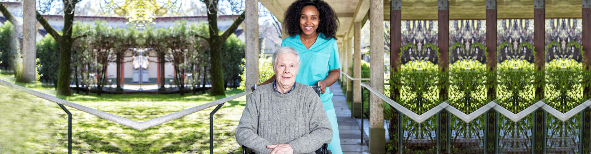a caregiver and a senior man in a wheelchair smiling